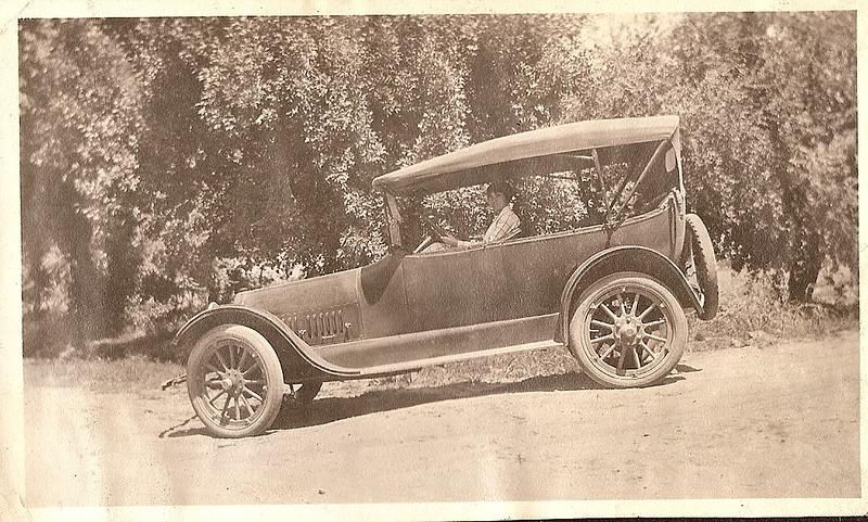 car n girl on dirt road.jpg