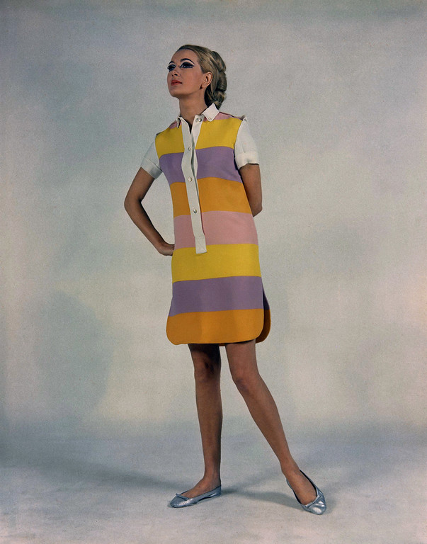 . A sea dress of heavy shantung in horizontal wide yellow, pink, violet, and orange-red stripes. Note splits in sides of dress and epaulets on shoulders and short sleeves of white pique. A creation of Princess Luciana of Rome, presented in Florence fashions Italian beachwear, Jan. 19, 1967. (AP Photo/Mario Torrisi)
