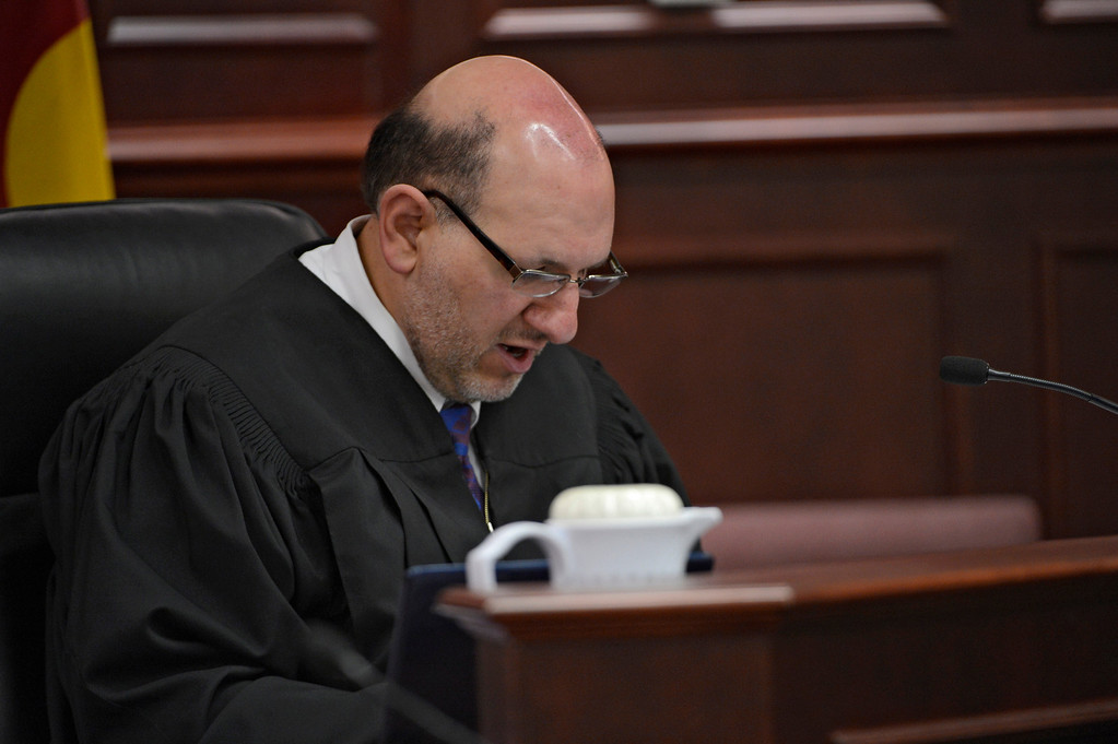 . Judge Carlos A. Samour Jr. reads an advisement during a hearing for Aurora theater shooting suspect James Holmes in Centennial, Colo., on Tuesday, June 4, 2013.   Judge Samour ruled prosecutors can have access to a notebook   Holmes sent to a psychiatrist before last summer\'s rampage.  (AP Photo/The Denver Post, Andy Cross, Pool)