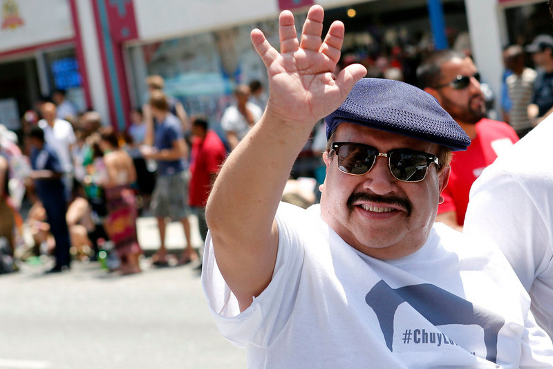 . Actor Chuy Bravo waves during the 43rd annual LA LGBT Pride Parade in West Hollywood, California June 9, 2013. The parade celebrates the lesbian, gay, bisexual and transgender (LGBT) communities in Los Angeles. REUTERS/Patrick T. Fallon