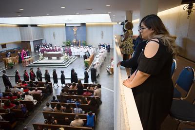 Zulina Ramirez, freshman at Donnelly, watches the graduates process in to Savior.