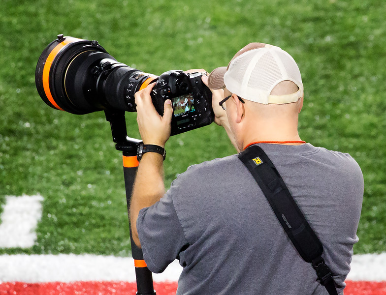 A cameraman catches a UConn fair catch.