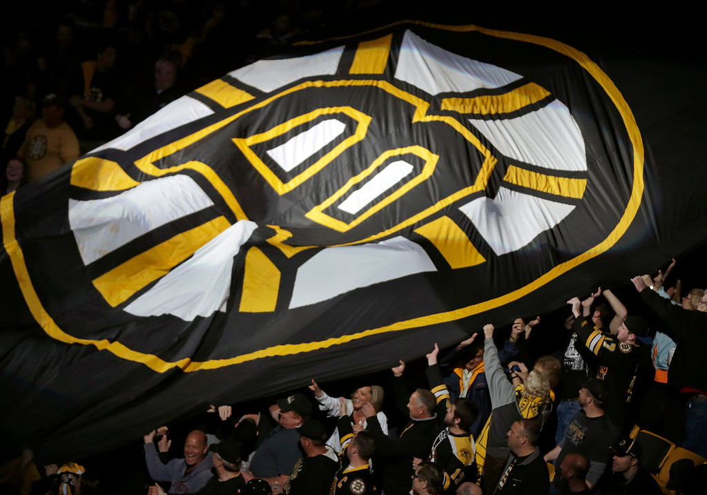 . Fans pass a large Boston Bruins banner around the arena prior to Game 4 in the Eastern Conference finals of the NHL hockey Stanley Cup playoffs between the Bruins and the Pittsburgh Penguins, in Boston on Friday, June 7, 2013. (AP Photo/Charles Krupa)