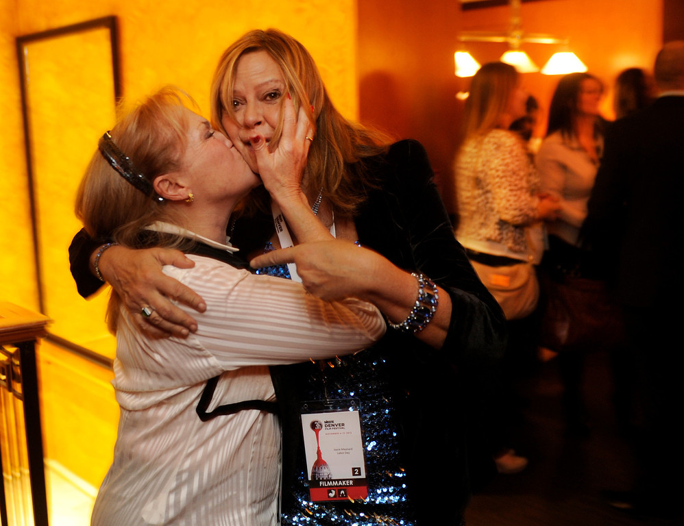 . DENVER, CO. - NOVEMBER 6: Lisa Gilford, left, planted a kiss on the cheek of author Joyce Maynard during opening night festivities for the 36th Starz Film Festival Wednesday night, November 6, 2013. The festival opened with a showing of the movie Labor Day starring Josh Brolin and Kate Winslet. Maynard wrote the book on which the movie is based. Photo By Karl Gehring/The Denver Post
