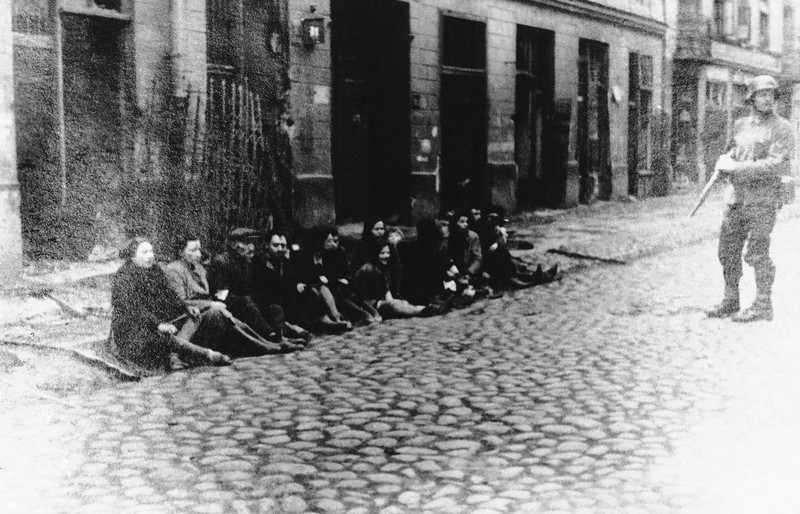 . A German officer rounds up Jews before the destruction of the Warsaw ghetto, Poland, 1943.  (AP Photo)