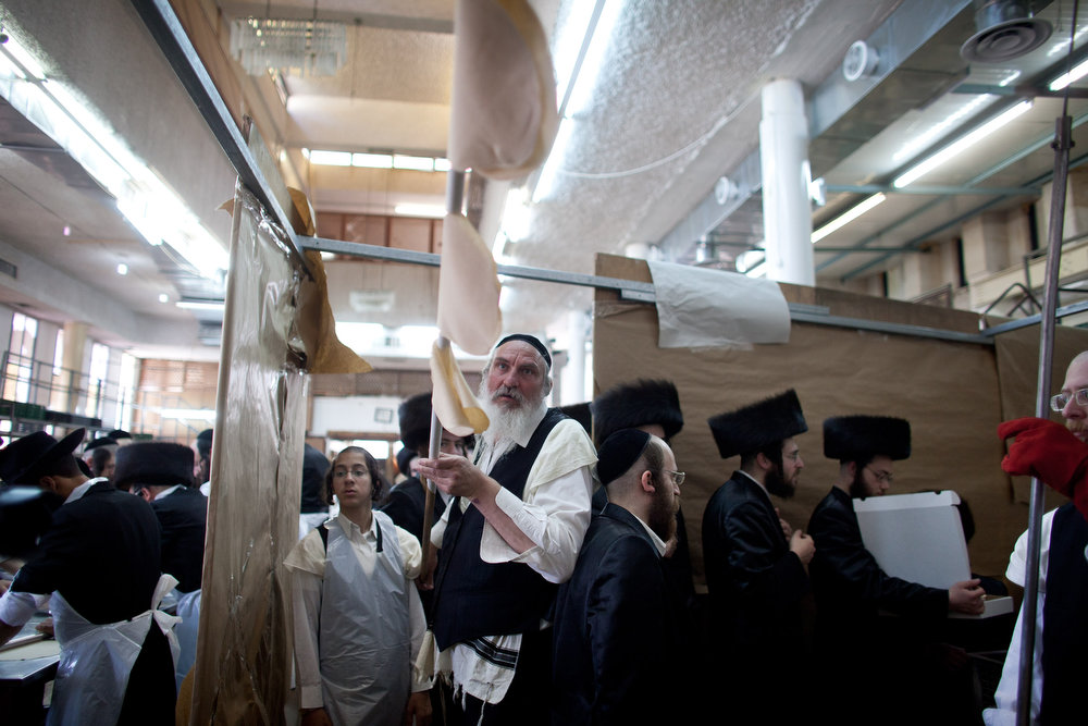 . Ultra-Orthodox Jewish men prepare Matzoth, or unleavened bread, in a final preparation before the start at sundown of the Jewish Pesach (Passover) holiday on March 25, 2013 in Bnei Brak, Israel. Religious Jews throughout the world eat matzoth during the eight-day Passover, or Pesach, holiday, The Jewish holiday commemorates the Israelis\' exodus from Egypt some 3,500 years ago and their ancestors\' plight by refraining from eating leavened food. Passover begins March 25 and ends on the evening of April 02.  (Photo by Uriel Sinai/Getty Images)