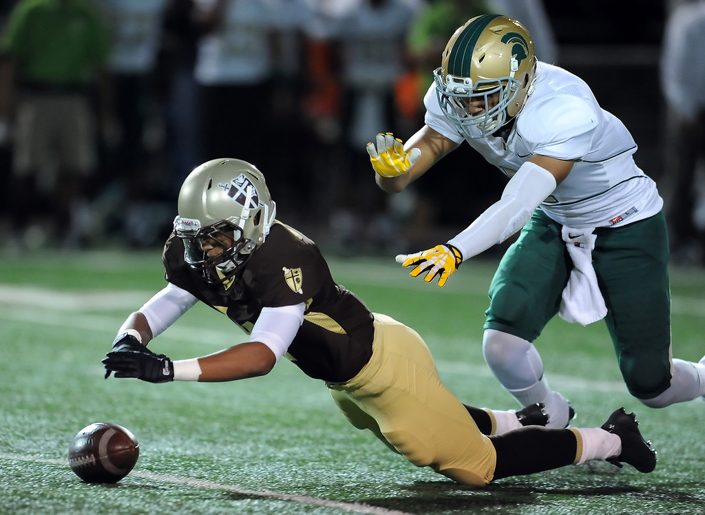 . St. Francis\' Mason Williams recovers a Damien fumble in the first half of a prep football game at St. Francis High School in La Canada, Calif., Friday, Sept. 27, 2013.   (Keith Birmingham Pasadena Star-News)