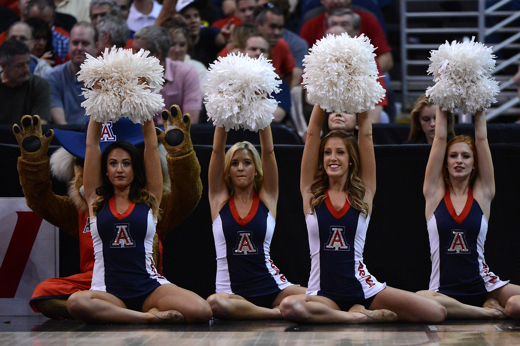 . Arizona Wildcats cheerleaders cheer on their team in the first half while taking on the Ohio State Buckeyes during the West Regional of the 2013 NCAA Men\'s Basketball Tournament at Staples Center on March 28, 2013 in Los Angeles, California.  (Photo by Harry How/Getty Images)