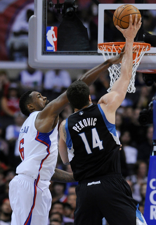 . Clippers#6 DeAndre Jordan gets in the way of Timberwolves#14 Nikola Pekovic in the first half. The Clippers defeated the Minnesota Timberwolves 111-95 in a game played at Staples Center in Los Angeles, CA 4/10/2013(John McCoy/Staff Photographer