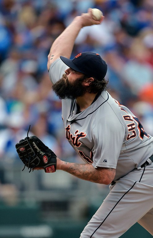 . Detroit Tigers relief pitcher Joba Chamberlain (44) throws against the Kansas City Royals during the eighth inning of a baseball game Saturday, Sept. 20, 2014, in Kansas City, Mo. (AP Photo/Reed Hoffmann)