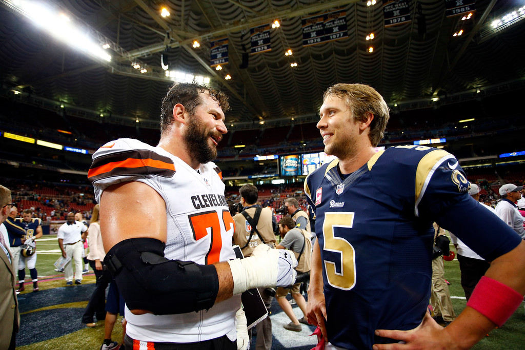 . St. Louis Rams quarterback Nick Foles, right, talks with Cleveland Browns offensive tackle Joe Thomas following an NFL football game Sunday, Oct. 25, 2015, in St. Louis. The Rams won 24-6. (AP Photo/Billy Hurst)