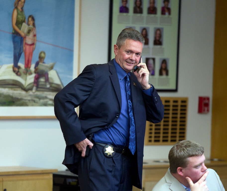 . Alameda County Sheriff Gregory J. Ahern, left, talks on the phone before the start of a hearing on his agency\'s plan to acquire a drone for aerial enforcement, Thursday, Feb. 14, 2013 at the Alameda County Administration Building in Oakland, Calif. (D. Ross Cameron/Staff)
