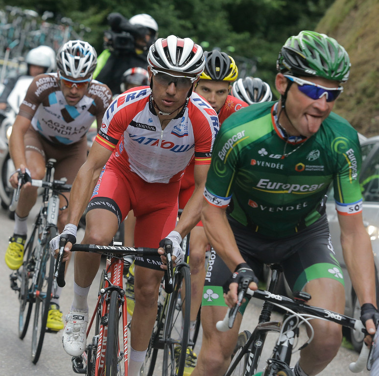 . France\'s Thomas Voeckler, right, Spain\'s Joaquim Rodriguez, center, and France\'s Christophe Riblon, left, ride in the breakaway during the tenth stage of the Tour de France cycling race over 161.5 kilometers (100.4 miles) with start in Mulhouse and finish in La Planche des Belles Filles, France, Monday, July 14, 2014. (AP Photo/Laurent Cipriani)