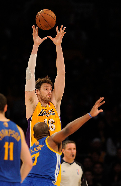 . The Lakers\' Pau Gasol #16 grabs a pass as the Warriors\' Carl Landry #7 defends during their game at the Staples Center in Los Angeles Friday, April 12, 2013. The Lakers beat the Warriors 118-116. (Hans Gutknecht/Staff Photographer)