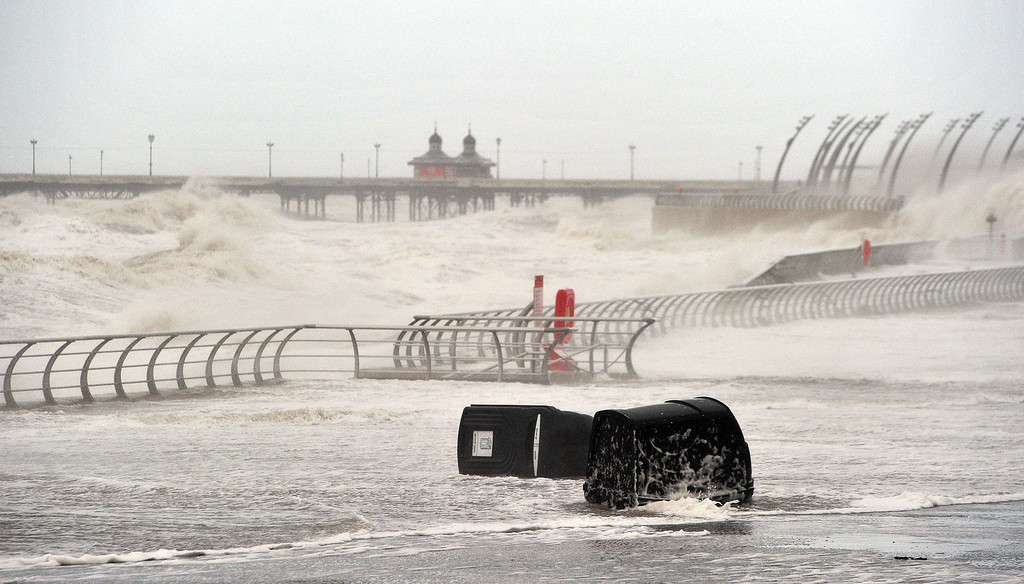 . Litter bins are washed along the promenade and waves batter the sea wall in Blackpool, north west England, on December 5, 2013 as high winds hit the north of England and Scotland.  AFP PHOTO / PAUL ELLIS/AFP/Getty Images