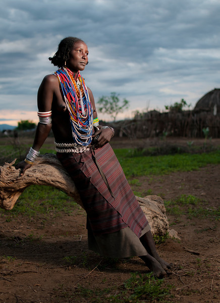 This is Lago, a married woman from the Arbore tribe.  Arbore men may take wives from Booran, Dassanech, Rendile or even Burji tribes, they will usually not take wives from Konso or Hamar tribes.  Only in the Kuyle region, Arbore men may marry women from the Tsamako tribe. In these cases other Arbore tribe people look down upon these marriages as Tsamako women are not circumcised.  Omo Valley, Southern Ethiopia, 2013.