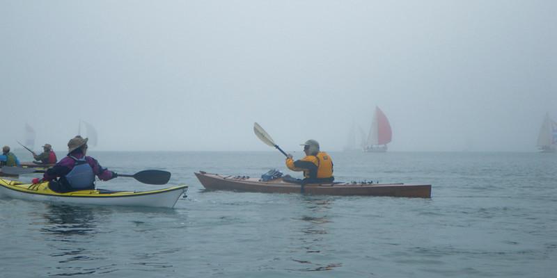Sailboat regatta in the fog.