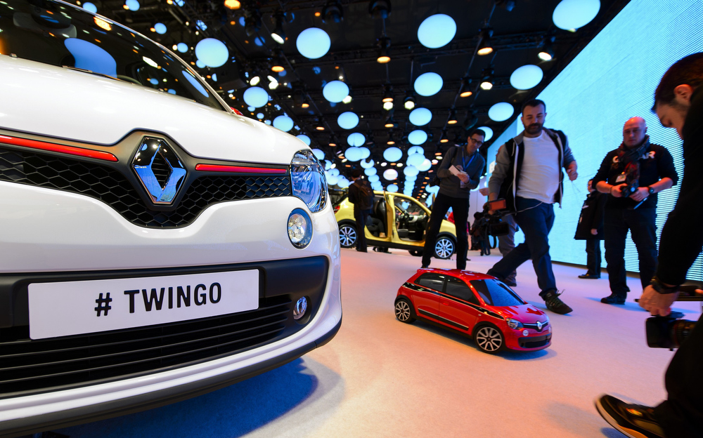 . A cameraman films a scale model of the new Twingo model car during a presentation by French carmaker Renault  on the press day of the Geneva Motor Show in Geneva, on March 4, 2014.  FABRICE COFFRINI/AFP/Getty Images