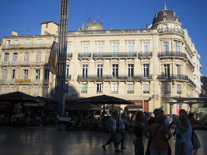 The main square in the Comedy is lined with restaurants and cafes with patios. While you eat on the patios, street entertainers perform for you. Location - Montpellier