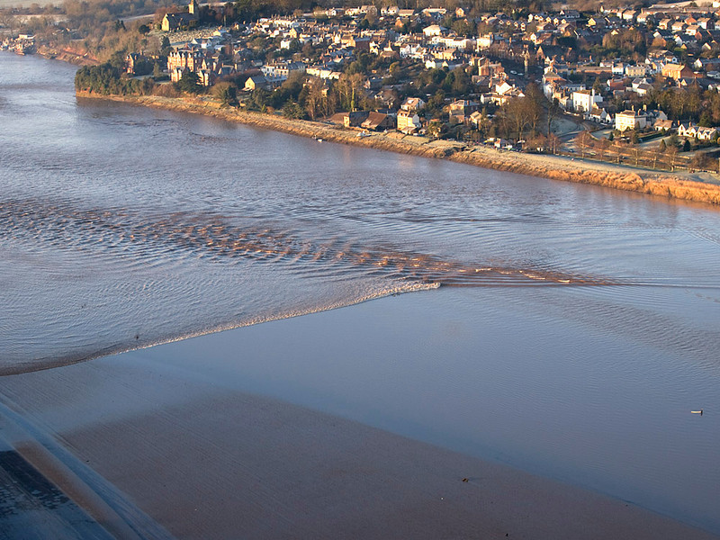 To witness the Severn Bore from the air is like nothing else. One can really appreciate the topography of the river as it channels the huge wave down the estuary and into the narrow sections upstream. The wave takes on many shapes and characteristics that just cannot be appreciated from the ground. It is a great vantage point to see the gravity waves. Most people perceive the bore to be a single wave. Check the images and dispel that myth. Olympus E3, 50-200mm SWD