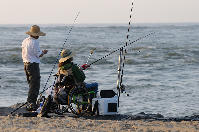 I have seen this couple fishing the inlet several times, inspiring! Love the light.