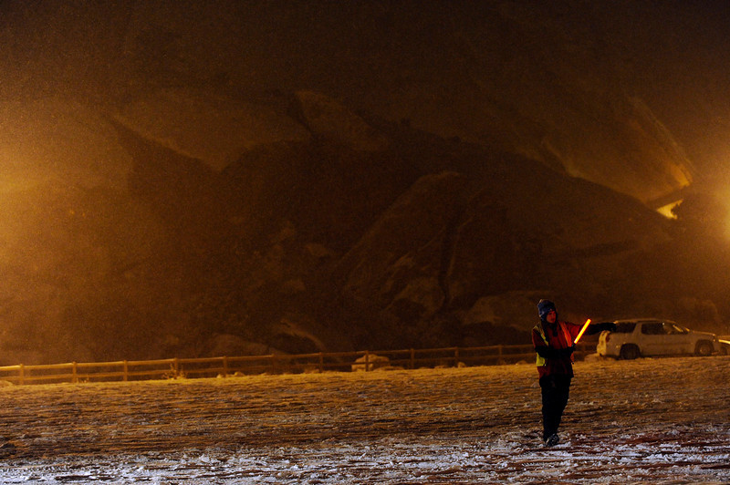 . A lot attendant directs traffic during Winter on the Rocks at Red Rocks Amphitheatre on January 31, 2014 in Morrison, Colorado. (Photo by Seth McConnell/The Denver Post)
