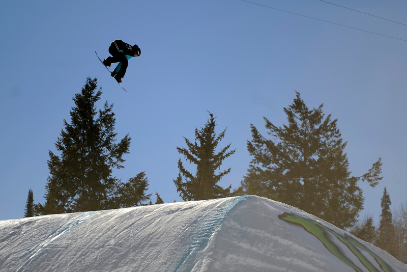 . Brandon Davis catches air at the men\'s snowboard slopestyle elimination in Aspen at Winter X Games in Aspen, January 22, 2014. The men\'s snowboard slopestyle final will be held Saturday afternoon on Buttermilk Mountain. 