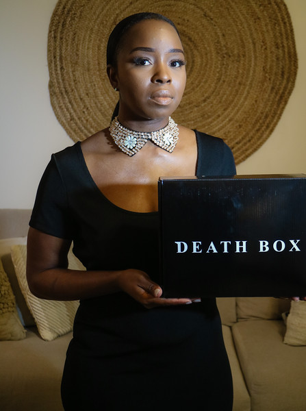 "Anteria Burgess, creator of the Death Box, stands in her Wellington home on Friday, Sept. 29, 2017. She came up with the idea for the Death Box after experiencing a devastating break-up. Inside are items she said are meant to ""rejuvenate"" women who have gone through similar heartbreak. (Joseph Forzano / The Palm Beach Post)"