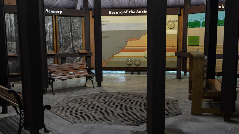 Inside a pavilion with geological interpretive displays