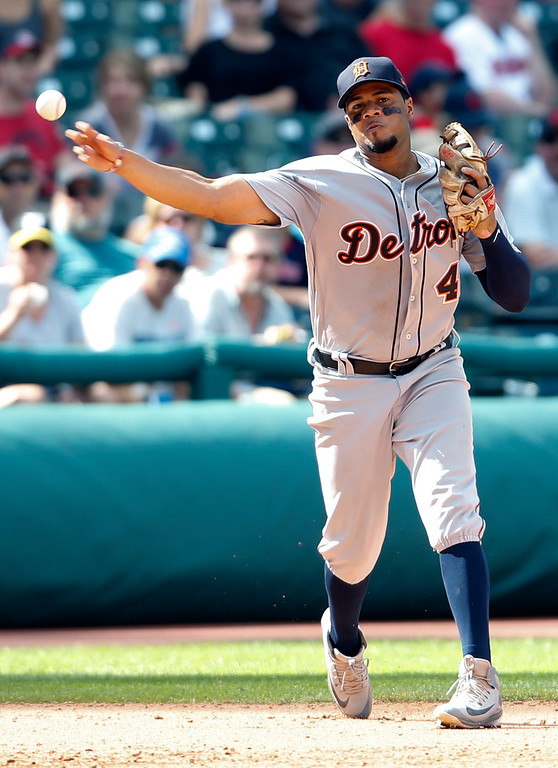 . Detroit Tigers\' Jeimer Candelario throws out Cleveland Indians\' Adam Rosales at first base during the seventh inning of a baseball game, Sunday, Sept. 16, 2018, in Cleveland. (AP Photo/Ron Schwane)