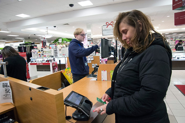 11/29/19 Wesley Bunnell | StaffrrBlack Friday shopper Luz Cruz, R, checks out of Kohl's on Friday afternoon with the help of Kohl's employee Jaydon Fournier