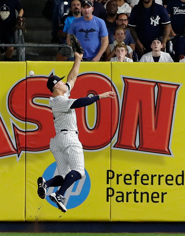 . New York Yankees right fielder Aaron Judge can\'t make the catch on a line drive hit by Cleveland Indians \' Jason Kipnis during the fourth inning in Game 3 of baseball\'s American League Division Series, Sunday, Oct. 8, 2017, in New York. Kipnis tripled on the play. (AP Photo/Frank Franklin II)
