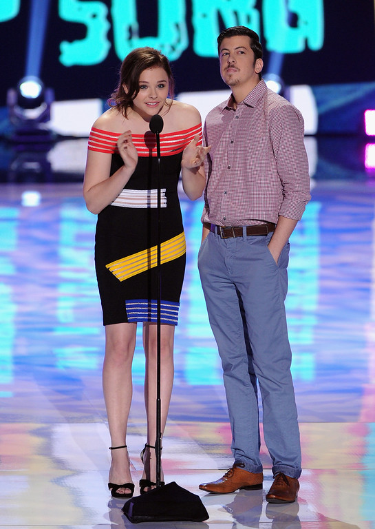 . Actors Chloe Grace Moretz (L) and Christopher Mintz-Plasse speak onstage during the Teen Choice Awards 2013 at Gibson Amphitheatre on August 11, 2013 in Universal City, California.  (Photo by Kevin Winter/Getty Images)