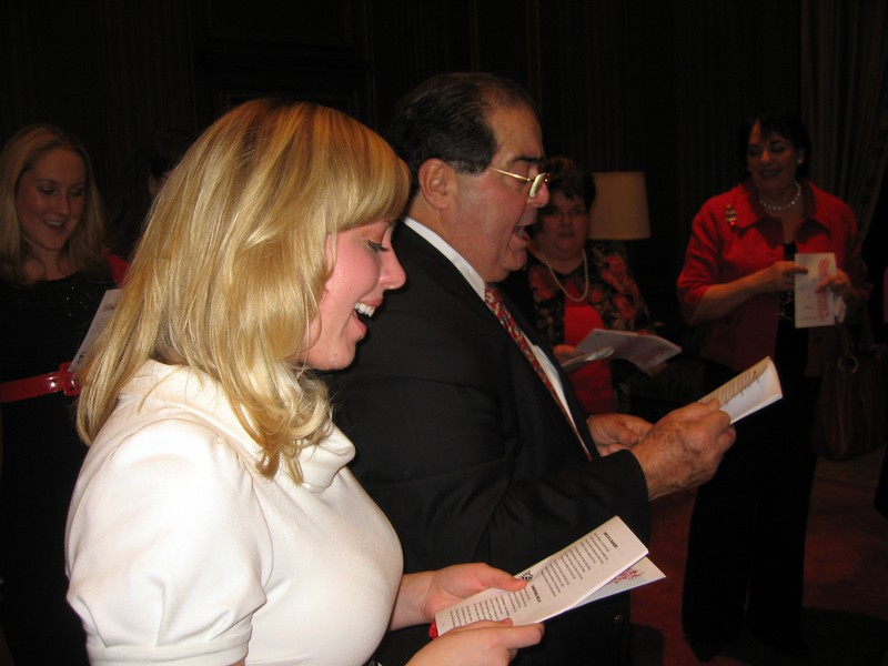 Katharine and Associate Justice Antonin Scalia sing Away in a Manger