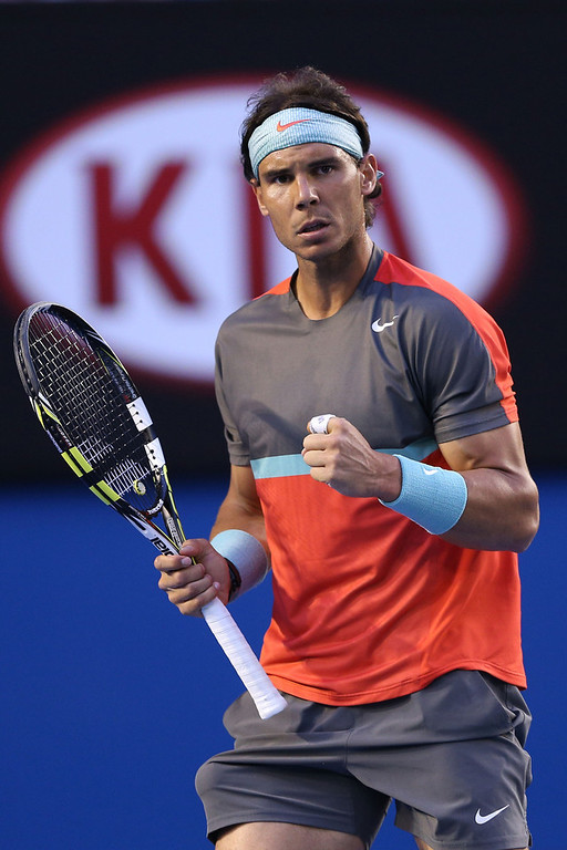 . Rafael Nadal of Spain celebrates a point in his semifinal match against Roger Federer of Switzerland during day 12 of the 2014 Australian Open at Melbourne Park on January 24, 2014 in Melbourne, Australia.  (Photo by Clive Brunskill/Getty Images)