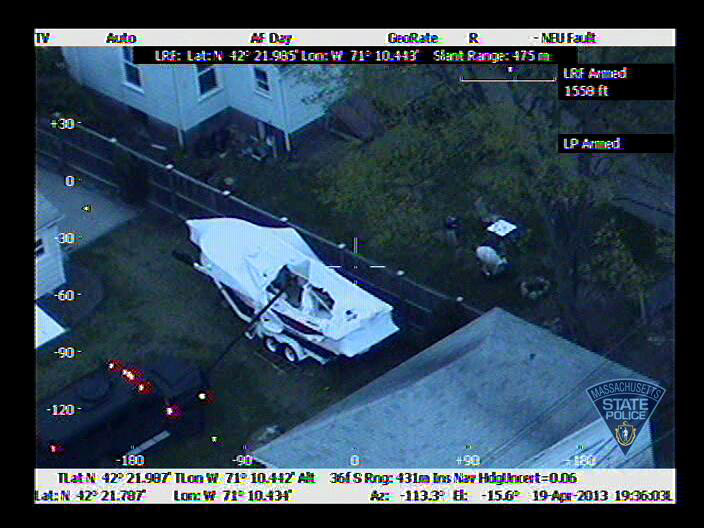 . WATERTOWN, MA - APRIL 19:  In this handout provided by the Massachusetts State Police, the boat in which Boston Marathon bombing suspect Dzhokhar A. Tsarnaev was hiding is seen from a police helicopter on Franklin Street on April 19, 2013 in Watertown, Massachusetts. A manhunt for Dzhokhar A. Tsarnaev, 19, a suspect in the Boston Marathon bombing ended after he was apprehended on a boat parked on a residential property. His brother Tamerlan Tsarnaev, 26, the other suspect, was shot and killed after a car chase and shootout with police. The bombing, on April 15 at the finish line of the marathon, killed three people and wounded at least 170  (Photo by Massachusetts State Police via Getty Images)