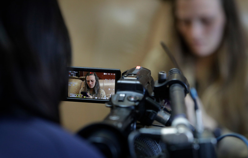 Alexandria Okomoni of WFXL, records Ashley VanGuilder, Mass Communication Specialist with the U.S. Navy, during their last assignments at the News Video Workshop on the campus of the University of Oklahoma in Norman, Okla, on Thursday, March 22, 2018. (Photo by Joe Mahoney)