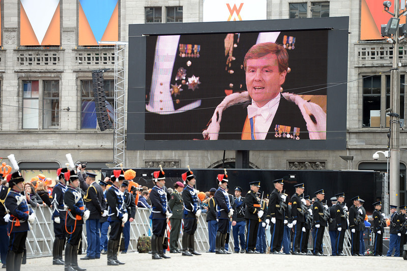 . King Willem-Alexander of the Netherlands is seen on a giant screen during his inauguration ceremony on April 30, 2013 at Nieuwe Kerk (New Church) in Amsterdam.  PATRIK STOLLARZ/AFP/Getty Images