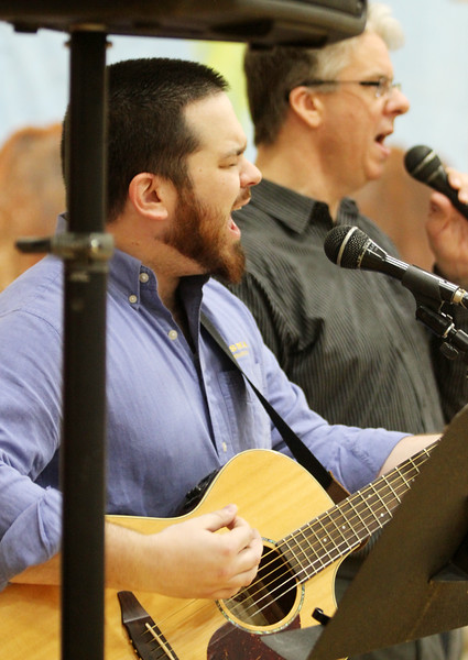 Harold Aughton/Butler Eagle: Guitarist Josh Thompson and Pastor Dan Ledford of the Westminster Presbyterian Church, Butler, sing praise songs  at the Sixty-Ninth Annual Butler Young Men's Christian Association Good Friday Fellowship Breakfast held at the Butler YMCA.