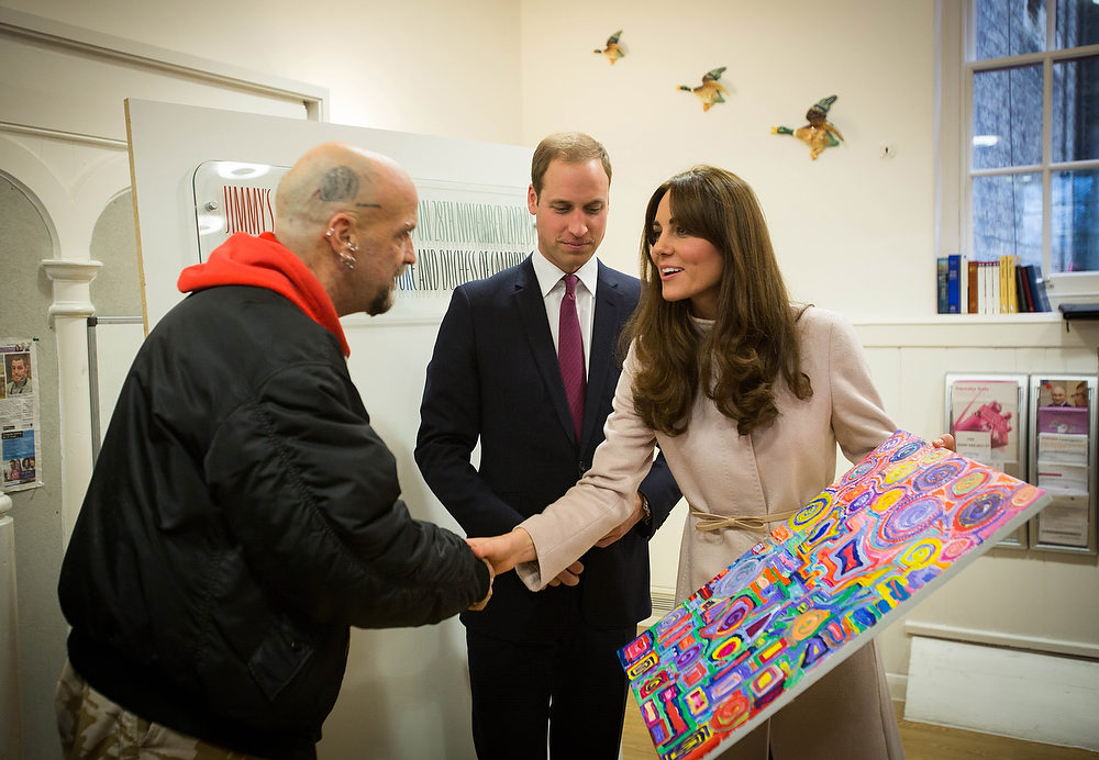 . Catherine, Duchess of Cambridge and Prince William, Duke of Cambridge receive a painting from former shelter guest Twig during their visit at \'Jimmy\'s\', a night shelter, on November 28, 2012 in Cambridge, England.  (Photo by Paul Rogers - Getty Images)
