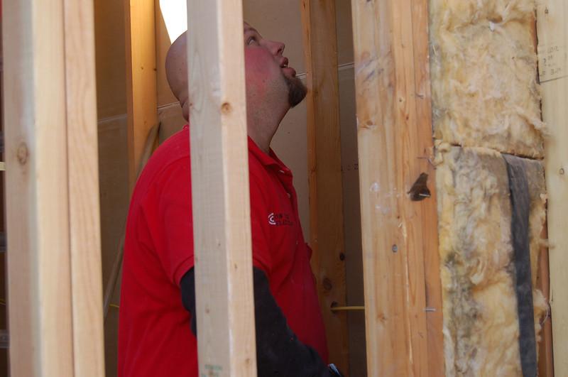 I haven't got a clue who this is or what he's doing - a plumber?
