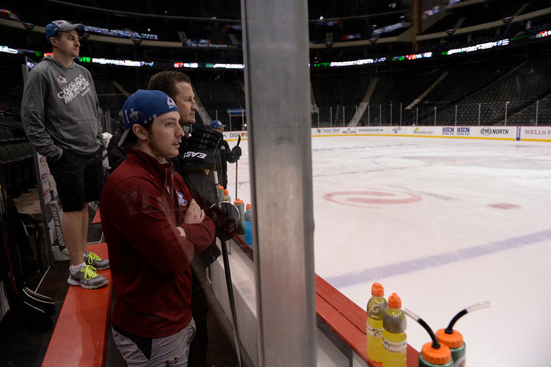 . Colorado Avalanche center Matt Duchene (9) watches the team practice from the bench April 23, 2014 at Xcel Energy Center. Duchene later dressed and ran through his drills at one end of the ice. (Photo by John Leyba/The Denver Post)