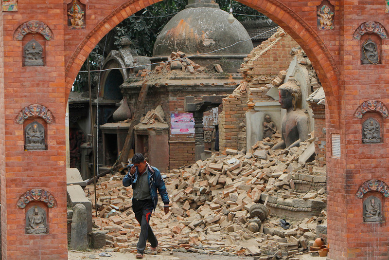 . A Nepalese man cries as he walks through the earthquake debris in�Bhaktapur, near Kathmandu, Nepal, Sunday, April 26, 2015. A strong magnitude 7.8 earthquake shook Nepal\'s capital and the densely populated Kathmandu Valley before noon Saturday, causing extensive damage with toppled walls and collapsed buildings, officials said. (AP Photo/Niranjan Shrestha)