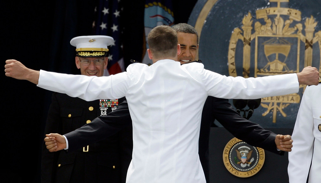 . President Barack Obama chest bumps with a graduate during the U.S. Naval Academy graduation and commissioning ceremony, Friday, May 22, 2009, in Annapolis, Md. (AP Photo/Rob Carr)