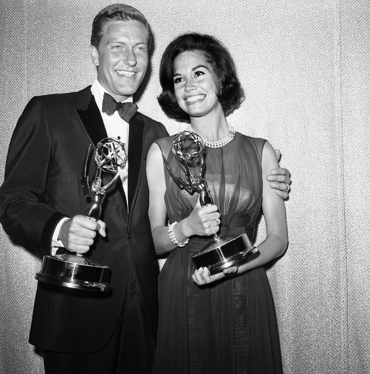 . Dick Van Dyke, left, and Mary Tyler Moore co-stars of The Dick Van Dyke Show pose backstage at the Palladium with the Emmys won in the Television Academy\'s 16th annual awards show, in Los Angeles, Calif. They won the Emmy Award for best actor and actress in a series. Van Dyke is the recipient of the Life Achievement Award at the upcoming 19th Annual SAG Awards ceremony on Sunday, Jan. 27, 2013. (AP Photo, File)