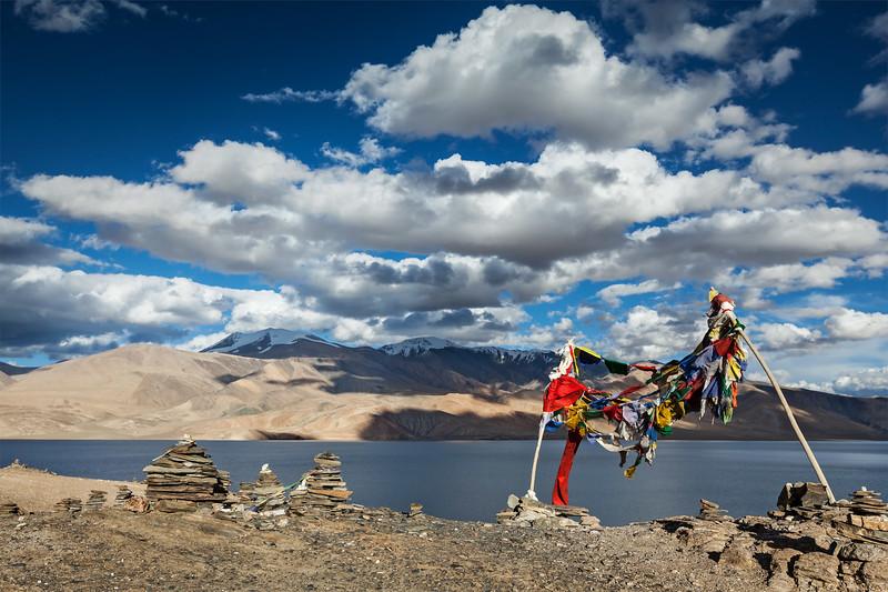 Buddhist prayer flags lungta at Himalayan lake Tso Moriri, Korzok, Ladakh, India