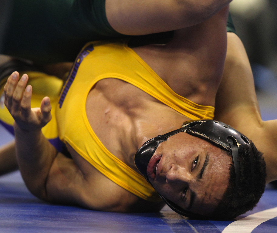 . Riordan\'s Zac Contreras, bottom, wrestles Poway\'s Victor Lopez in a 145-pound third place match during the California Interscholastic Federation wrestling championships in Bakersfield, Calif., on Saturday, March 2, 2013. Lopez would go onto win the match. (Anda Chu/Staff)