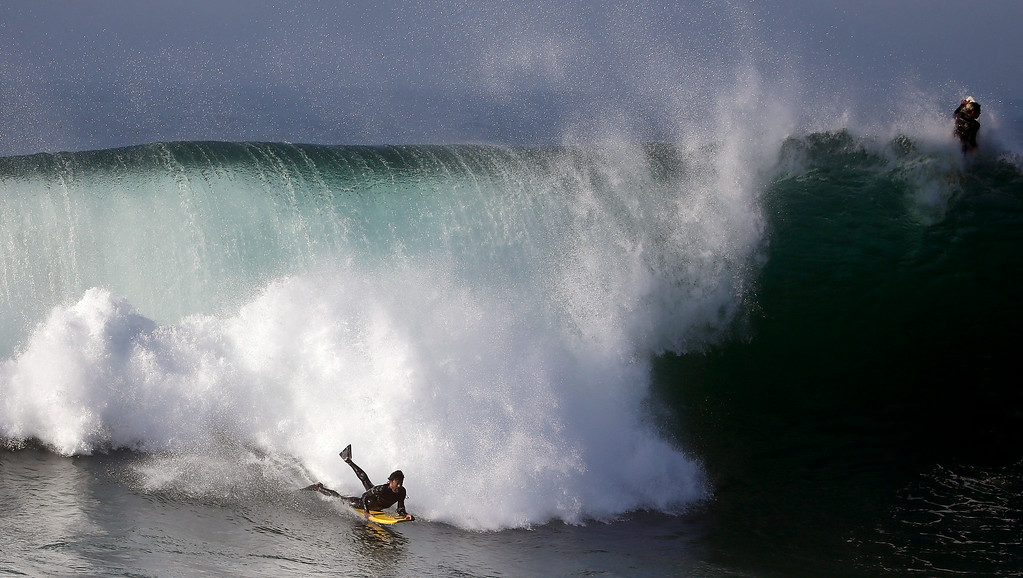 . A bogieboarder rides a wave at the wedge in Newport Beach, Calif., Wednesday, Aug. 27, 2014. Southern California beachgoers experienced much higher than normal surf, brought on by Hurricane Marie spinning off the coast of Mexico. (AP Photo/Chris Carlson)