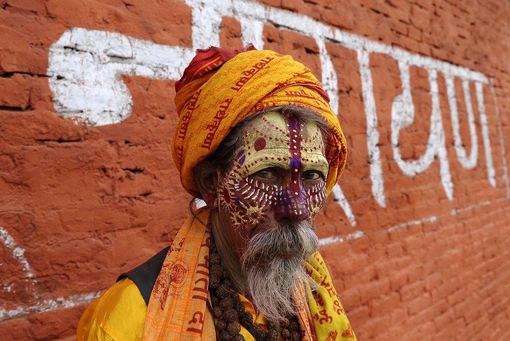 . A Nepalese Sadhu (Hindu holy man) poses for a photograph ahead of the forthcoming Hindu Maha Shivaratri festival near the Pashupatinath Temple in Kathmandu on February 25, 2014.  AFP PHOTO/Prakash  MATHEMA/AFP/Getty Images