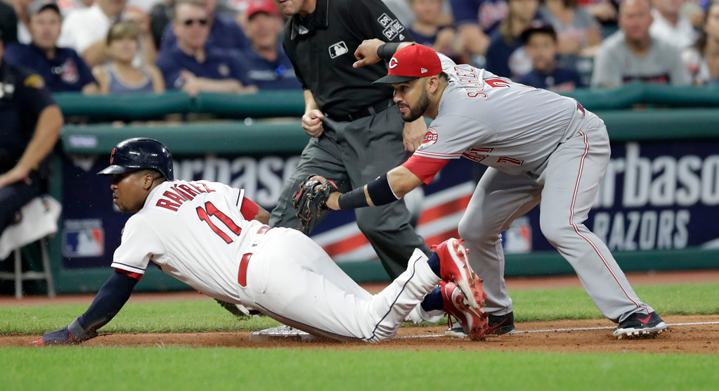 . Cleveland Indians\' Jose Ramirez, left, is safe at third base as Cincinnati Reds\' Eugenio Suarez can\'t make the tag in the eighth inning of a baseball game, Tuesday, July 10, 2018, in Cleveland. (AP Photo/Tony Dejak)